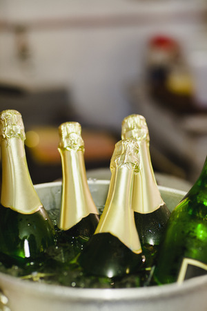Close up of bucket of champagne LANG_EVOIMAGES