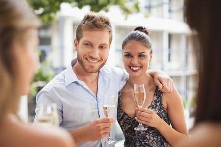 lavishly: Couple drinking champagne together