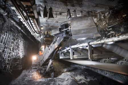 dirtied: Coal miner working in mine LANG_EVOIMAGES