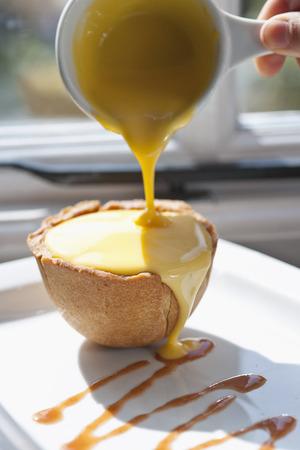 Custard sauce over hot apple pie