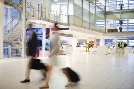go inside: Blurred view of business people in lobby