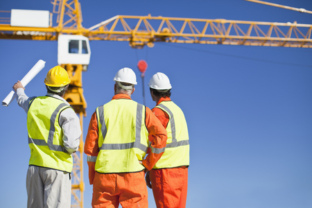 affiliation: Workers talking at construction site LANG_EVOIMAGES