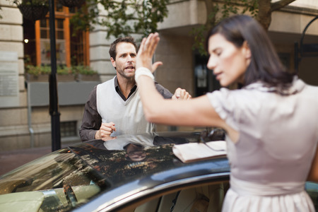 disagreed: Couple arguing over sports car LANG_EVOIMAGES