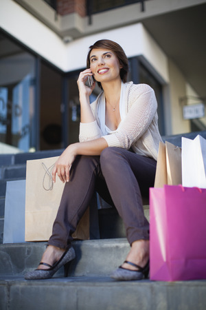 talker: Woman talking on cell phone outdoors