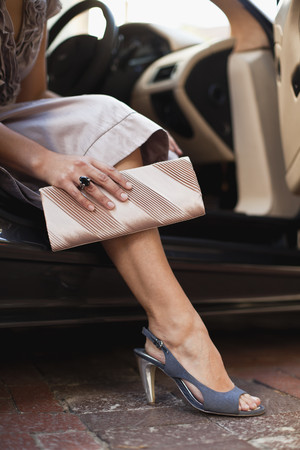 low section: Close up of womans shoes and purse LANG_EVOIMAGES