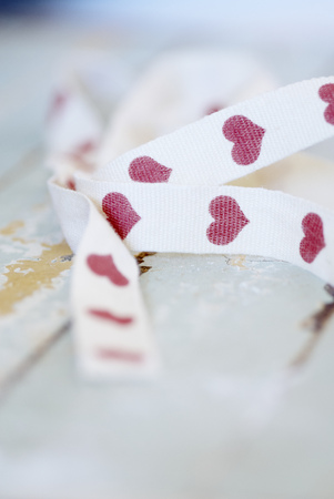 Close up of ribbon with hearts on it