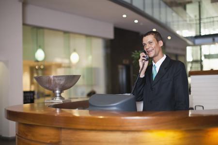 talker: Hotel concierge talking on phone