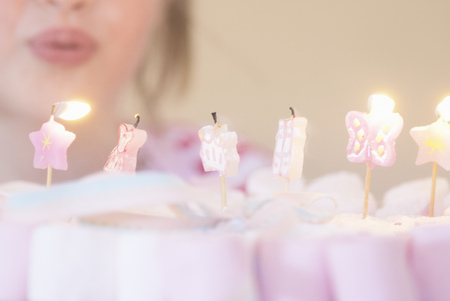 marshmellow: Girl blowing out candles on candies