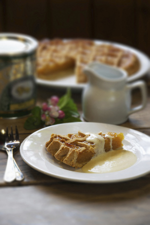 Slice of treacle tart with cream
