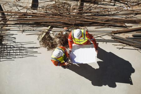 defended: Workers reading blueprints on site