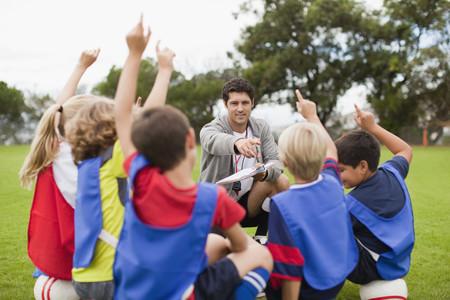 acknowledging: Children raising hands during practice