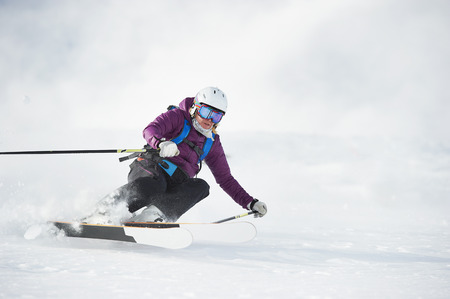 Skier skiing on snowy slope LANG_EVOIMAGES