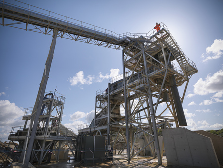 mined: Worker standing on conveyor in quarry LANG_EVOIMAGES