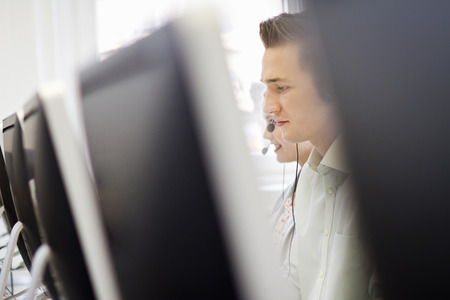 handsfree telephones: Businessman working in headset