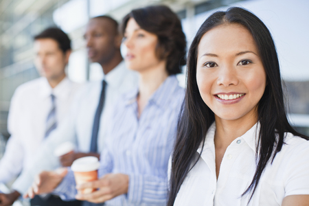 Close up of businesswomans smiling face LANG_EVOIMAGES