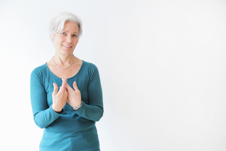 grays: Smiling woman gesturing with hands