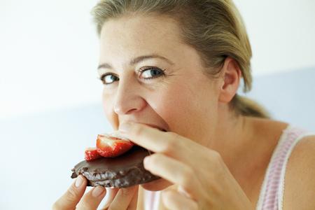 Smiling woman eating cake