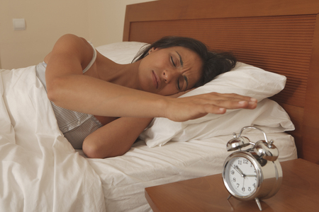 ceased: Woman turning off alarm clock