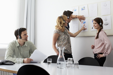 hands free device: Business people in headsets in meeting
