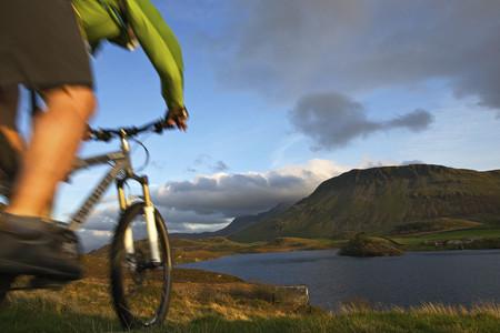 north western european descent: Blurred view of mountain biker