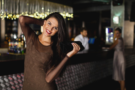 Smiling woman standing in bar