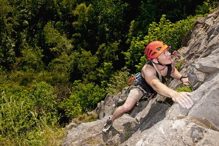 scaling: Climber scaling steep rock face