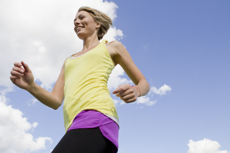 physically fit: Woman jogging outdoors LANG_EVOIMAGES