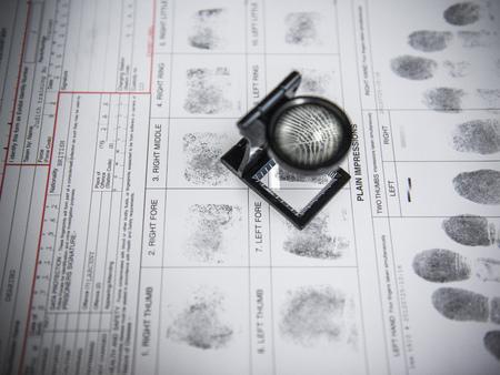 identifiers: Loupe over fingerprints on arrest form