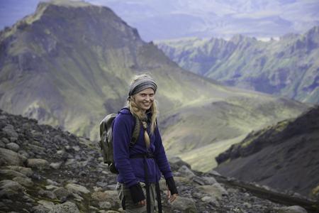 mountainous: Hiker standing on rocky hillside