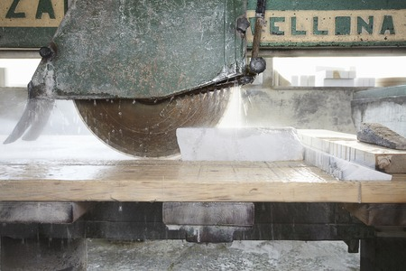 sopping: Machinery cutting stone on board LANG_EVOIMAGES