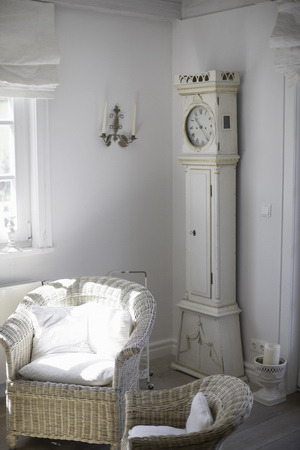 timepieces: Wicker chairs and clock in living room