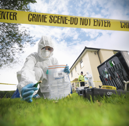 Forensic scientist at crime scene