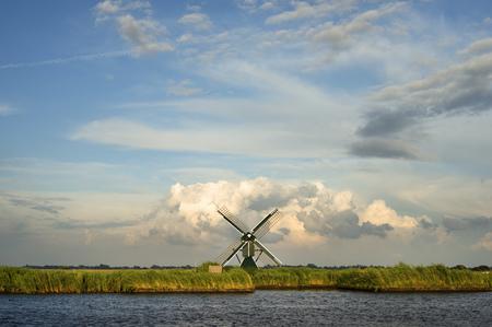 Windmill in rural landscape