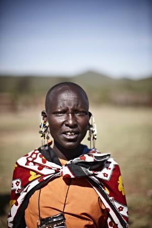 Maasai woman standing outdoors LANG_EVOIMAGES