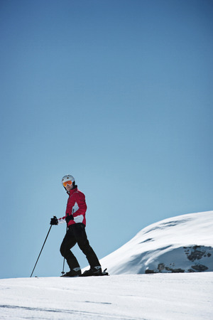 looking away from camera: Skier coasting on snowy slope