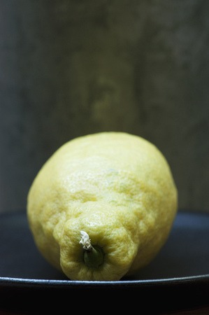 close up food: Close up of unwaxed lemon on plate