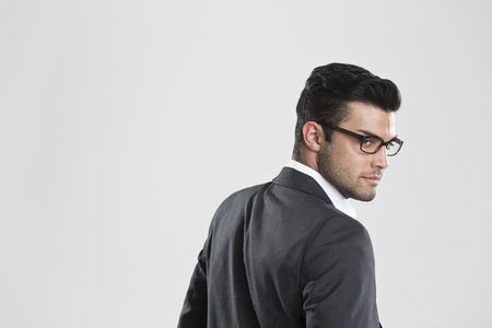 welldressed: Businessman looking over his shoulder