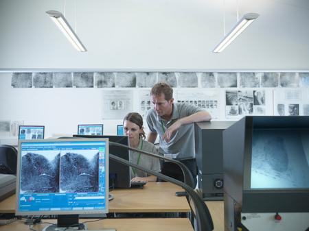 Forensic students examining fingerprints