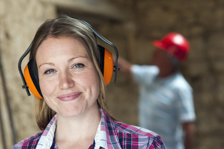 defended: Construction worker wearing headphones LANG_EVOIMAGES