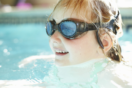 Close up of girl swimming in pool