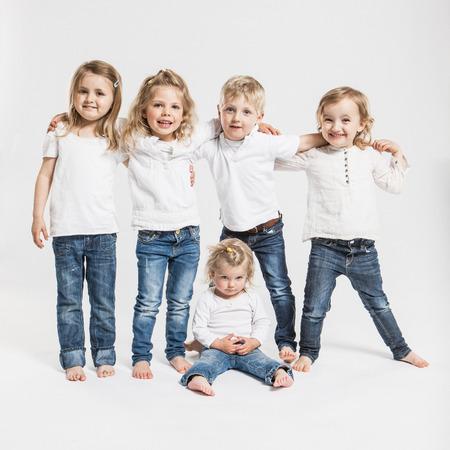 equivalents: Smiling children posing together