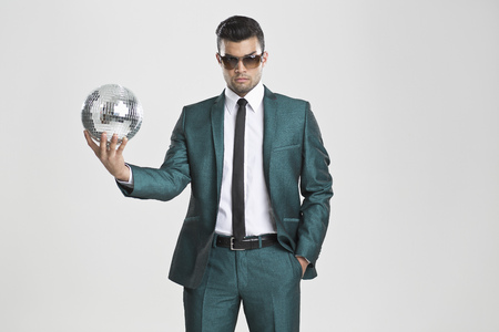 welldressed: Businessman holding disco ball