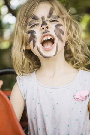 merciless: Girl wearing face paint outdoors