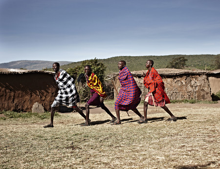 Maasai men walking together LANG_EVOIMAGES