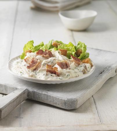 egglayer: Plate of chicken bacon caesar salad LANG_EVOIMAGES