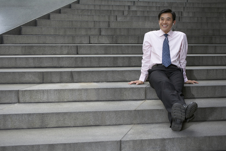 musically: Businessman listening to headphones