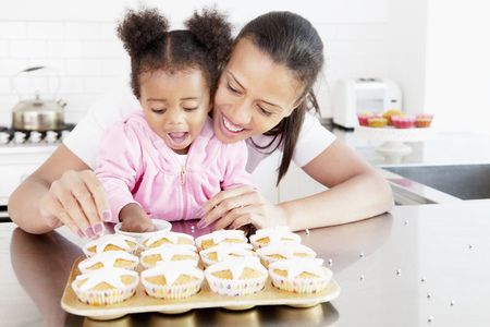 cherished: Mother and daughter baking together