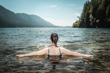 Woman walking in still lake