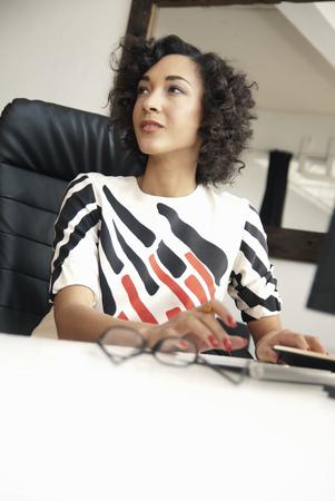 Businesswoman sitting at desk