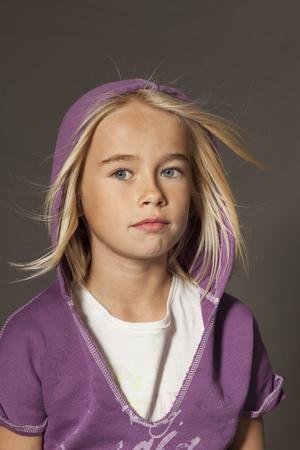 wind blown hair: Girl standing in studio